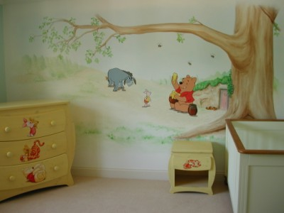 Pooh bear mural in a baby s room