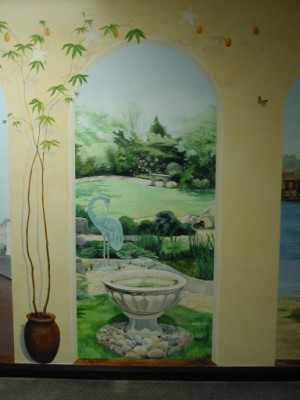 Close up of mural depiciting hospice garden scene